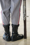 Military boots and rifle close up. Close up of a guards boots and bayonet rifle stock image