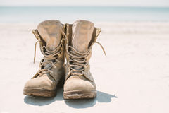 Military boots on the sand in the sun Royalty Free Stock Image