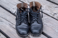 Military boots on wood planks Stock Photos