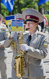Military brass band. Female saxophone, performer. Victory Day, May 9 Military brass band. Female saxophone, performer Royalty Free Stock Photos