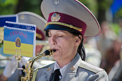 Military brass band. Female saxophone, performer. Victory Day, May 9 Military brass band. Female saxophone, performer Stock Photos