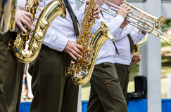 military brass band playing saxophones and trombones during music fest stock photo