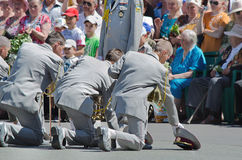 Military brass band. Victory Day, May 9. Victory Day, May 9. Men, were, on one knee, in front of the veterans, respect Stock Image
