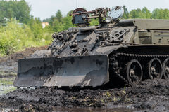 Military bulldozer in mud Stock Photography
