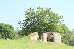 Military bunker hidden on meadow Royalty Free Stock Photos
