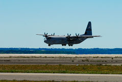 Military C-130 plane. A United States Air Force National Guard C-130, based out of Quonset (North Kingstown) Rhode Island takes off to perform at the Quonset Stock Photos