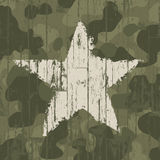 Military camouflage background with star. Stock Image