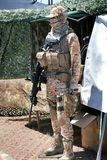 Military camouflage equipment with weapons Stock Photos
