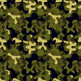 Military camouflage pattern to disguise in the forest Royalty Free Stock Photos
