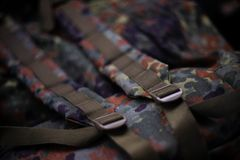 Military camouflage roomy backpack. In the frame of the strap and the back of a backpack. Close-up view stock image