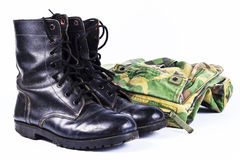 Military camouflage uniforms. And boots Through use stock photography