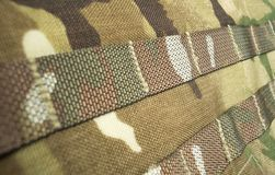 Military camouflage webbing material on a British army MTP rucksack / backpack. Potential use as a backdrop / background royalty free stock photos