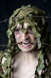 Military camouflaged man Stock Photography