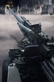 Military cannon in the battle Stock Photo