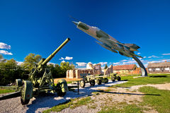 Military cannon and fighter jet Stock Photos
