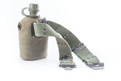 Military canteen and army belt on white background Stock Photo