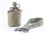 Military canteen and army belt on white background Royalty Free Stock Photography