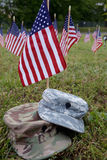 Military cap and american flags Royalty Free Stock Photos