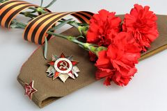 Military cap, order of Great Patriotic war, flower Stock Photography