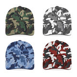 Military caps. Four realistic military caps on white background. Vector EPS10 illustration Stock Photos