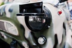 Military car headlight close up. Royalty Free Stock Image