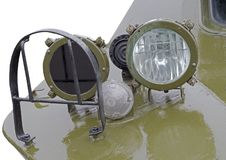 Military car headlight with disguise. Closeup royalty free stock photo