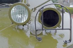Military car headlight with disguise. Closeup royalty free stock images