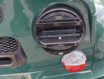 Military car headlight with disguise. Closeup royalty free stock photography