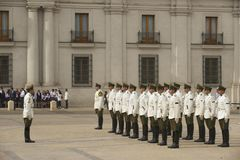 Military of the Carabineros band attend changing guard ceremony in front of the La Moneda presidential palace, Santiago, Chile. Royalty Free Stock Photos
