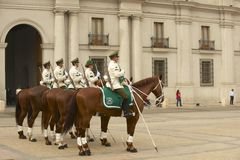 Military of the Carabineros band attend changing guard ceremony in front of the La Moneda presidential palace, Santiago, Chile. Stock Photography