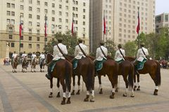 Military of the Carabineros band attend changing guard ceremony in front of the La Moneda presidential palace, Santiago, Chile. Stock Image