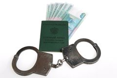 Military card of officer, handcuffs and money isolated. Military card of officer, handcuffs and money on white background Royalty Free Stock Image
