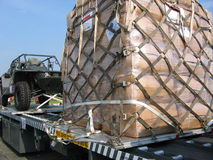 Military cargo. To be taken to aid in relief of disaster area Stock Image