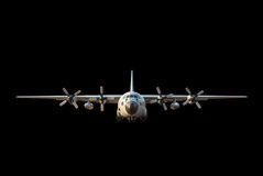 Military cargo aircraft on black background. Stock Image