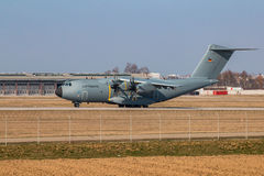 Military cargo airplane Airbus (A-400M)-Atlas. Military cargo airplane doing some special training landings and takeoffs Royalty Free Stock Photo