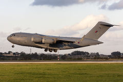 Military cargo jet landing Royalty Free Stock Photography