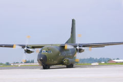 Military cargo plane. Taxiing on runway Royalty Free Stock Photo