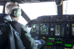 Military carrier airplane cockpit and pilots Stock Images