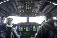 Military carrier airplane cockpit and pilots Royalty Free Stock Images