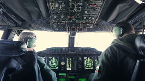 Military carrier airplane cockpit and pilots stock footage