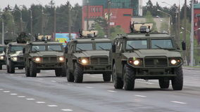 Military cars going through the city, Hummers, infantry, Russian army. Russian army, special car transports Battle Tank stock footage
