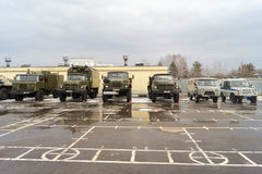 Military cars stand on the parade ground in a military unit in t Royalty Free Stock Photos