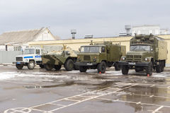 Military cars stand on the parade ground in a military unit in t Royalty Free Stock Photography