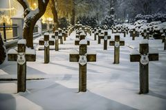 Military cemetery covered with snow. War cemetery in Siedlce, Poland covered with snow at night stock photo