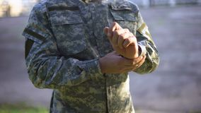 Military commander fixing uniform, professional serviceman, mission camouflage stock footage