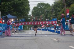 Military Competition Winner Breaks Tape At Atlanta 10K Road Race Royalty Free Stock Photo