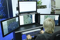 Free Military Computer-assisted Dispatch Station For Reconnaissance And Coordination Units, Monitors And Operator Working Stock Photography - 182032662