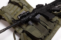 Military concept. Tactical vest and assault rifle. US military concept. Tactical vest and assault rifle close-up. Studio shot royalty free stock photography