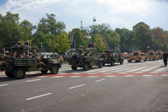 Military convoy. Polish forces in Warsaw. WARSAW, POLAND - AUGUST 15, 2014: Military convoy. Polish forces in Mercedes-Benz G and Humvee cars during Polish Armed Stock Image