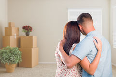 Military Couple Facing Empty Room with Packed Moving and Potted Stock Photography